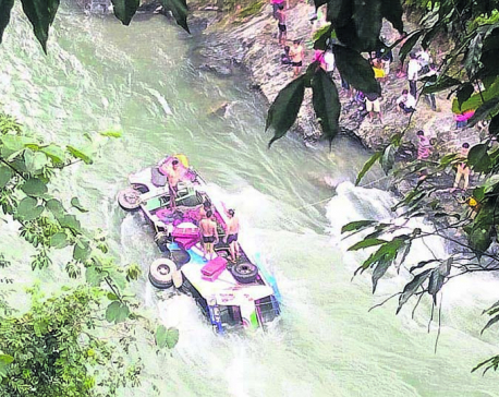 Bus plunges into river, two killed