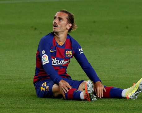 Barca's Griezmann injured, likely to miss title run-in