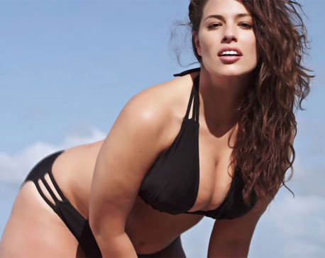 Sizzling Ashley Graham showcases cleavage in string bikini as she wishes fans Merry Christmas