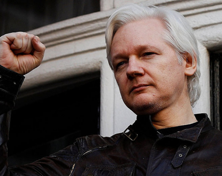 Ecuador's President says wants to find solution to Assange case without trouble