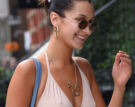 Braless Bella Hadid stuns as she hits the streets in plunging nude coloured top