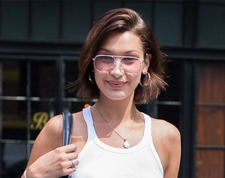 Bella Hadid beats the heat by going braless again