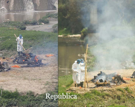 Dead bodies of corona infected being cremated on open ground (photo feature)