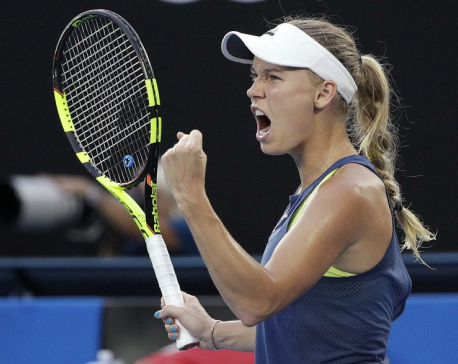 Wozniacki beats Halep to win 1st major at Australian Open