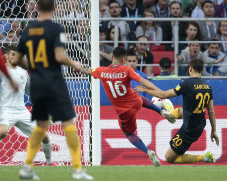 Chile draws with Australia to reach semis