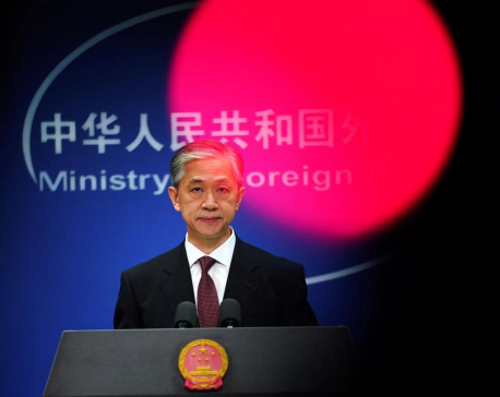 China vows retaliation if any U.S. action against journalists