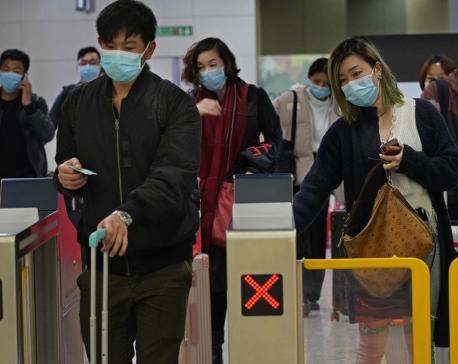 Hong Kong halts trains from mainland China as virus spreads
