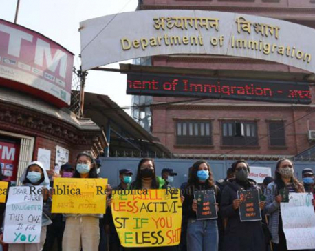 IN PICS: Activists demonstrate in front of Immigration Department against proposed travel regulation for women