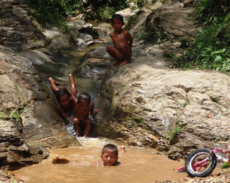 Kids romp around in rain-fed rivulet (photo feature)