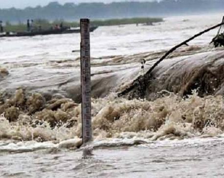 Flood sweeps away a vehicle in Dang