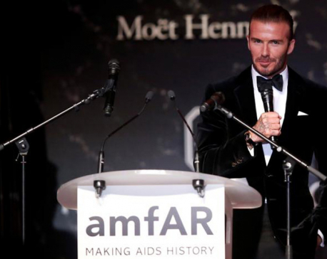 Bidding for Beckham: Football star among lots at Cannes AIDS auction