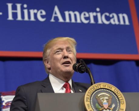 AP Explains: Behind the visa program targeted by Trump