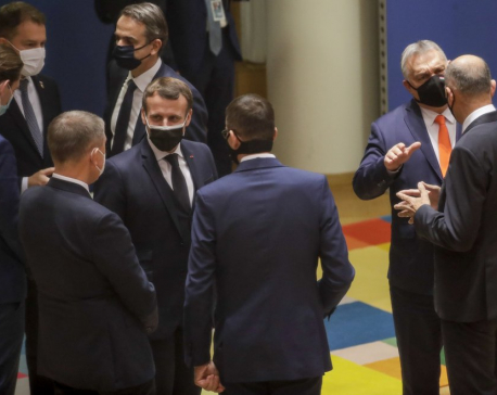 EU leaders agree to reduce emissions after all-night talks