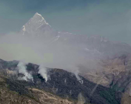Forest fire smoke obscures view of Mt Machhapuchchhre in Pokhara