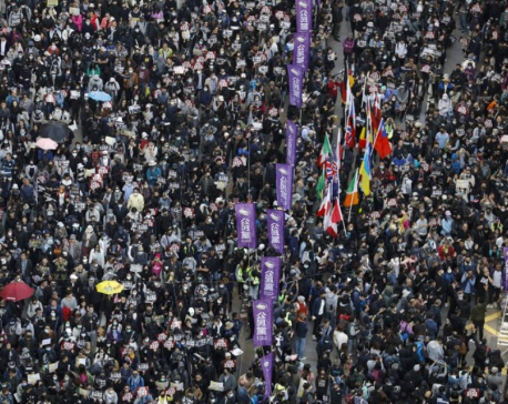 Thousands march as Hong Kong protests near half-year mark