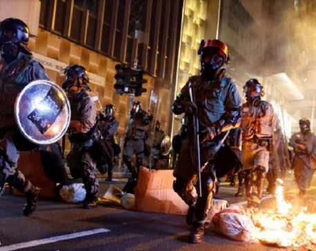 China warns U.S. of retaliation for law backing Hong Kong protesters
