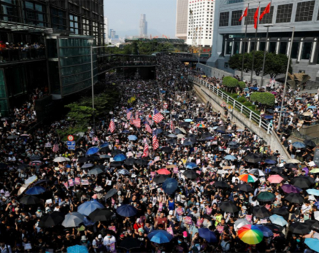 Hong Kong police fire tear gas as clashes erupt after thousands appeal to Trump