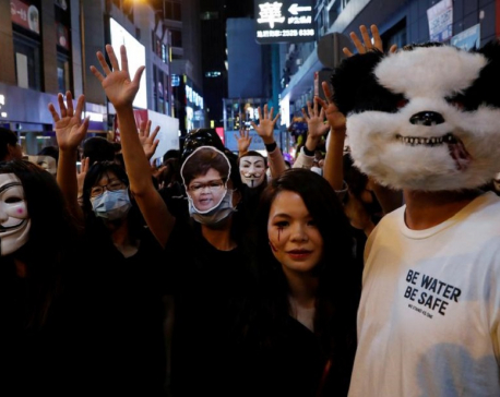 HK police fire tear gas in Kowloon as protesters across harbour gatecrash Halloween