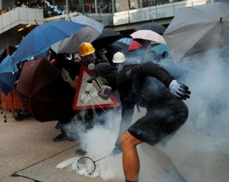 Battered and bruised, Hong Kong cleans up for sensitive Chinese anniversary