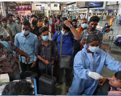 India's coronavirus cases peak over 12 million for first time