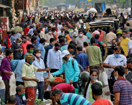 Indian coronavirus cases surge to new record as health system staggers