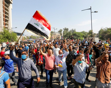 Iraqis gather for more protests after violence kills 40