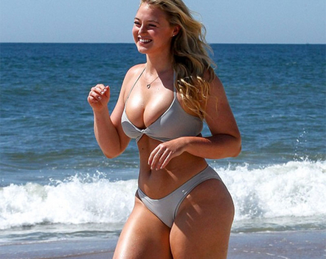 Iskra Lawrence flashes flirty smile in a swimsuit