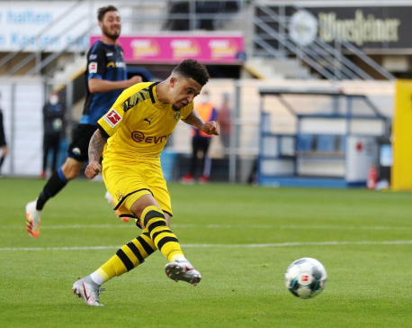 Sancho hat-trick keeps Dortmund in title hunt