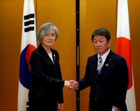 In bid to repair ties, Japan and South Korea agree to summit next month