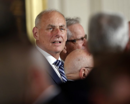Kelly flexes muscle his first day on the job at White House