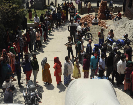 Amid lockdown order, people queuing up for govt relief without maintaining social distancing (with photos)