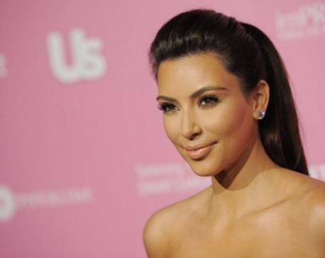 Kim Kardashian goes topless, ignites controversy
