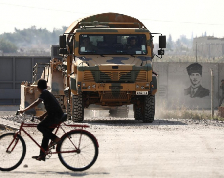 Russia says Syrian Kurd forces pulling back from Turkish border