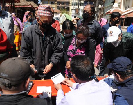 People queuing up at fair price shops in Patan without maintaining social distancing (with photos)