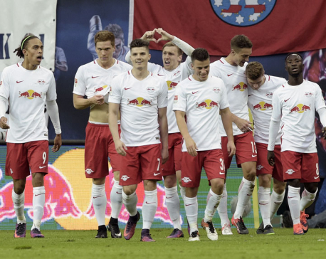 Promoted Leipzig brushes off critics to go top of the table