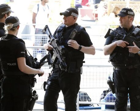 UK lowers terror threat level to 'severe' as more arrested