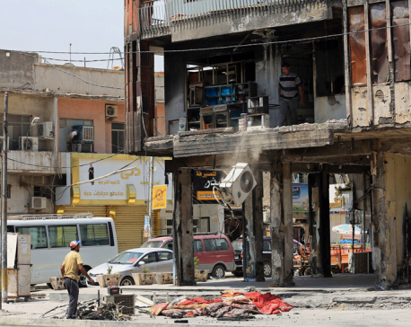 IS car bombing kills at least 12 civilians in Iraqi capital