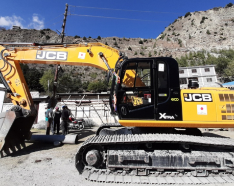 Japan hands over excavator to Tukche village