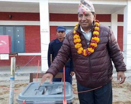 Left alliance candidate Narayan Kaji casts his vote