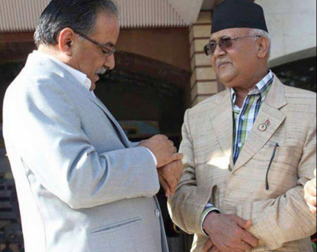 Maoists won't join govt until unification deal: Dahal to Oli
