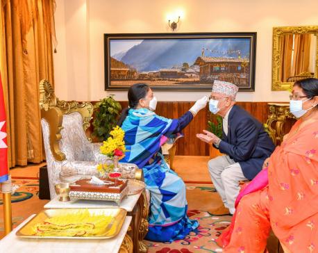 President Bhandari offers tika to Prime Minister Oli, first lady Shakya