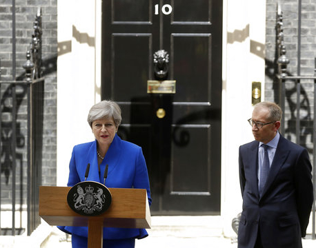 Clinging on to her job, Britain's May appoints new ministers
