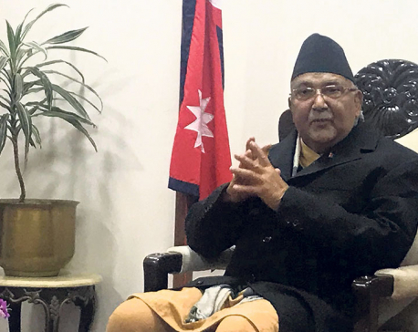 PM Oli weighs in to defend bribe-accused Baskota