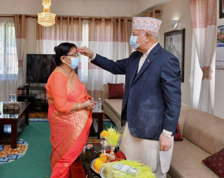 PM Oli offers Dashain 'tika' and 'jamara' to spouse Radhika Shakya