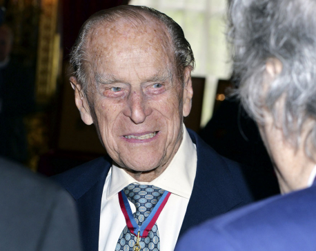 "Prince Philip hospitalized with infection but is in ""good spirits"""