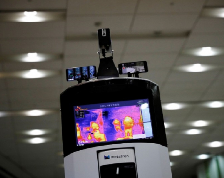 Armed with disinfectant and admonishments, South Korean robot fights coronavirus spread