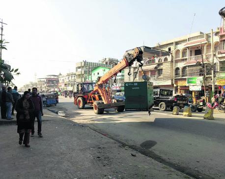 Birtamod bulldozing illegal roadside structures