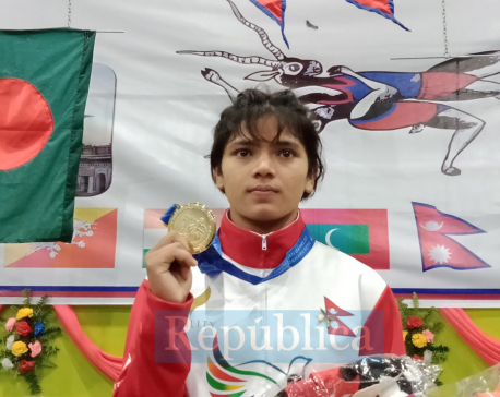 Dhami bags historic wrestling gold