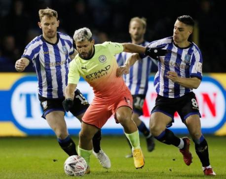 Aguero sends City through, Norwich knock out Spurs