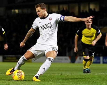 Sharp lifts Sheffield United top of Championship